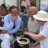 Mr Charles Hanson in deep conversation with Sir Bobby and Lady Norma Charlton.