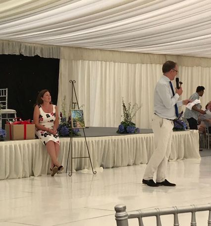 Mr Charles Hanson in action during prize auctions with Mrs Julia Needham in the background.